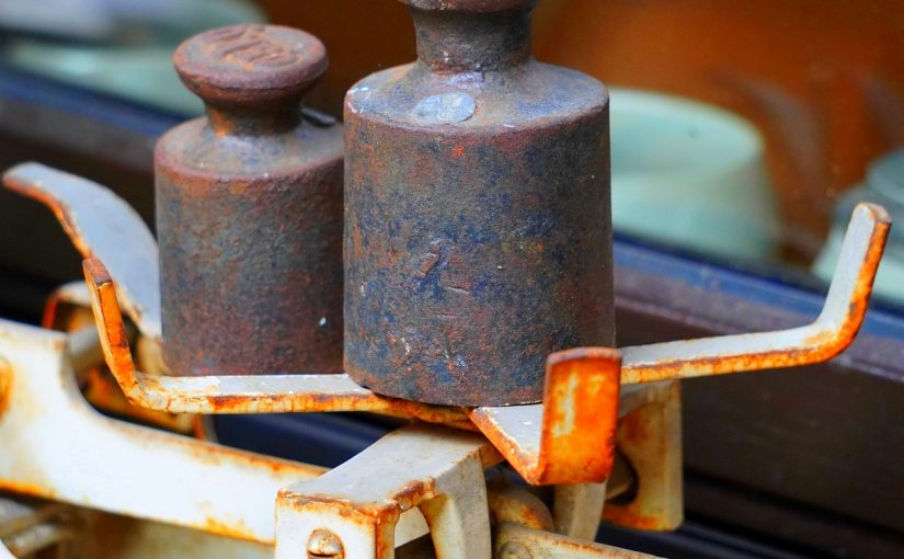 Picture of rusty weights on a scale