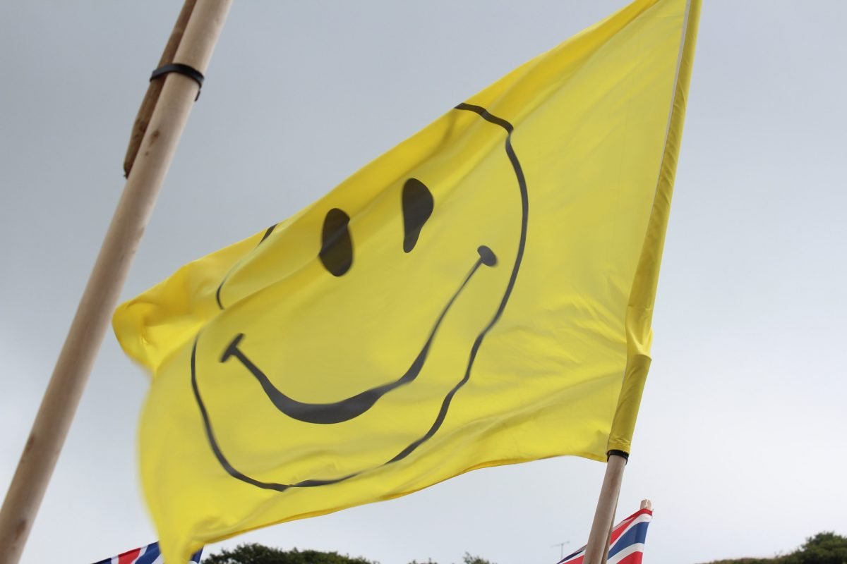 Smiley face emoji flag, Solva harbour, Wales